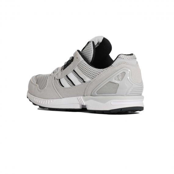 کفش زدایکس طوسی و مشکی با کیفیت و با قیمت مناسب دارای رویه مش بسیار سبک از نمای 3رخ بیرون پا چپ
