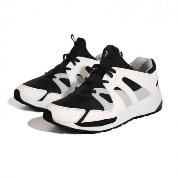 بهترین کفش طبی ارتوپدی مناسب مردان و زنان شیک پوش به رنگ سفید با رویه و بندهای مشکی جفت شده از بغل