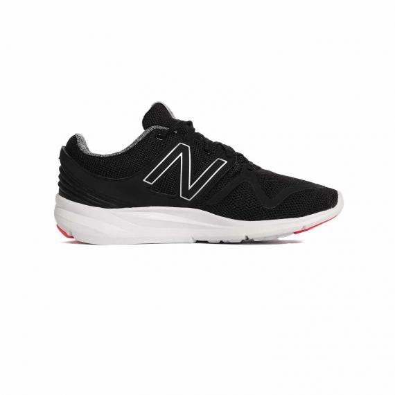 کفش اصلی نیو بالانس زنانه مخصوص پیاده روی با لایه میانی سفید و رویه مشکی از نمای داخل پا چپ