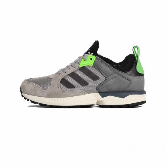 کفش مردانه ZX ادیداس با رویه مش و چرم مصنوعی توسی، 3 خط توسی تیره در کناره ها، لایه میانی سفید و دو بخش فسفری در پشت پاشنه و کناره بندهای کفش