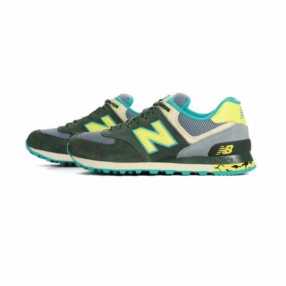 کتانی نیو بالانس دخترانه با رنگ سبز ارتشی و زرد مخصوص درمان خار پاشنه از نمای بغل کفش جفت شده